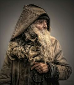 Bearded man in hooded coat - source unknown