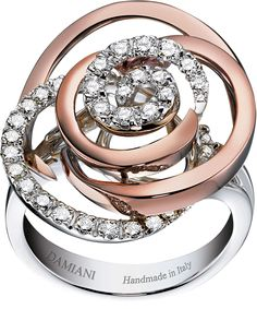 Damiani. ROSE. WHITE, PINK GOLD AND DIAMOND (ct 0.56) RING. Interesting