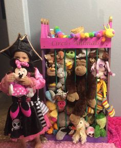 Adorable way to display and store all those cute stuffed animals.    Stained with 3 colors and lettering of your choice. You see the natural beauty of the wood grain, knots, etc.              Ideas for lettering:  My Zoo  Katie's Zoo  Our Zoo  Circus Animals  Wild Things    4ft tall by 2ft wide by 1ft deep    Easy to assemble- no dangerous or complicated cords    Comes with hardware to secure to wall- children will climb on anything!    Open on top for easy clean up, flexible bars to pull…