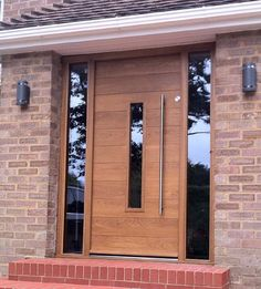Cool wooden front door with glass!