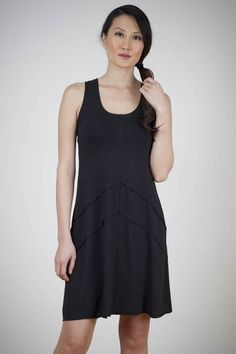 Now available at Showroom! The era of Peace and Love are channeled in this raw edged, racerback, trapeze tank dress.    We recommend a slip, unless you love your thighs.   rayon poly spandex Hand Wash Cold, Line Dry Cool iron if necessary Made in USA  J5325 in Charcoal Melange  Limited Edition