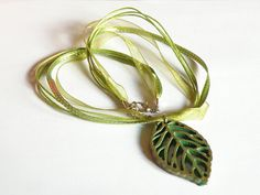 """Resin Leaf Necklace  GREEN & BRONZE by Biberta on Etsy, €15.00  THIS LOVELY ITEM HAS BEEN SELECTED TO BE PART OF THE """"LOVE ATTACK DAY"""" PROMOTED BY ETSYITALIATEAM"""