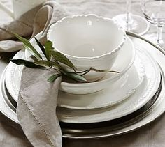 All white but different patterns. Tons of personality! Napoli Dinnerware #potterybarn