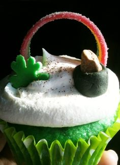 St. Patrick's day cupcakes. White cake dyed in 3 shades of green and made with only box cake mix and diet 7-up.  Topped with lite whip cream, fondant clover and pot, chocolate gold rock, edible gold glitter, and a rainbow sour candy strip.