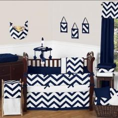 The Navy and White Chevron 9 piece crib bedding set has all that your little bundle of joy will need.  Let the little one in your home settle down to sleep in this incredible nursery set.  This unisex baby bedding set features a large chevron print.  This collection uses the stylish colors of navy blue and white.