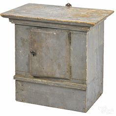 """Painted pine hanging cupboard, 19th c., retaining an old gray surface, 22 3/4"""" h., 18 1/2"""" w., 16"""" d."""