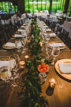 greenery runner, photo by Teale Photography http://ruffledblog.com/elegant-rainy-day-wedding #weddingideas #tablescapes