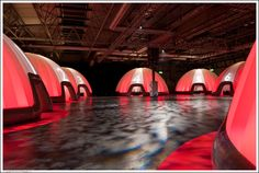 Inflatable dome structures in red lighting.  Can be used for exhibitions, pop-up office and meeting spaces, pop-up shops or backstage, chill out areas.   #EvolutionDome #PopUpDome #InflatableStructures #Moodlighting #TemporaryStructures #Backstagearea #PopUpOffice #MeetingArea #PopUpStores