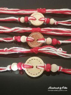 """Мартеница с бяло/червено копче, дървени мъниста и традиционните бяло-червени нишки за пролетния празник. Мартеницата завършва с регулатор на дължината. ------------------------- #martenica #martenitsa #spring #Bulgariantraditions #handmade #БабаМарта #традиции """"#мартеници #мартеница Button Bracelet, Bracelets, Baba Marta, Clothes Hanger, Hangers, Handicraft, Crochet, Spring, Holiday"""