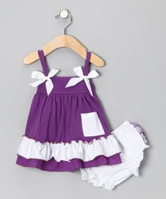 Cute as can be, this sweet babydoll top is crafted in a cotton blend and is accented by bows. Its short back offers a sneak peek at the ruffled behind on the flouncy pair of bloomers.Includes top and bloomers97% cotton / 3% spandexMachine wash; tumble dryImported