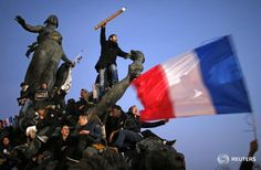 .@Reuters photo: A man holds up a giant pencil during the #MarcheRepublicaine in Paris. #CharlieHebdo