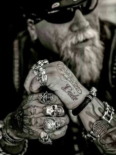 Old school biker wearing biker rings over a unique tattoo on his right hand.  #BikerRings