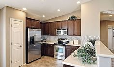 Looking for a new home in Tucson? One of the nation's leading new homebuilders, Richmond American Homes, has been building new construction in the Tucson area for over 35 years. Choose from a variety of floor plans and design options. Dark Cabinets, Kitchen Cabinets, Richmond American Homes, Stainless Appliances, New Construction, Building A House, Kitchens, New Homes, Floor Plans