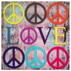 Collage art print celebrating two of life's greatest ambitions: peace and love. 1960s peace signs and the word 'Love' are rendered in a unique color palette against a distressed background. Printed on