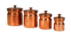 Click Pin it to share this product on Pinterest! Set of four decorative copper containers with lids and wood knobs, assorted sizes. From Tagus, Portugal; 1950s. Named the Best of Boston Home 2010...