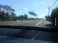 Tried to take a photo of a grasshopper on my windshield, but it looks like its giant and destroying the town.