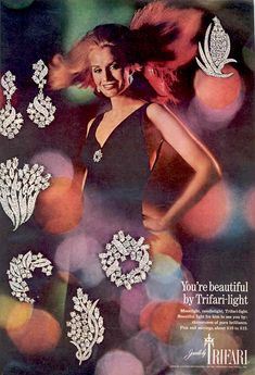 """1968 - TRIFARI - ADS - """"Trifari Light Collection"""" - You're beautiful by Trifari-light. Moonlight, candlelight, Trifari-light. Beautiful light for him to see you by: rhinestones of pur brilliance. Pins and earrings about $10-15. Vogue 1968."""