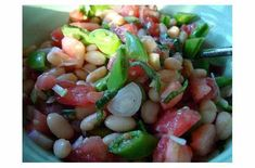 Summer Bean Salad   Photo: Jenny MacKinnell Ingredients 1 can of cannelini beans, drained and rinsed fresh herbs, finely chopped (your choice) 1 large tomato, chopped 2 green onions, chopped handful of pea pods (from my farmer's market and used for some crunch factor), chopped 1 garlic clove, minced juice of one lemon 2 tablespoons white wine vinegar 1/4 []