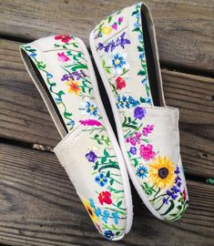Best 12 A wonderful Spring shoe! These custom toms are adorned with a variety of hand painted flowers. Perfect for spring and summer fashion or a great gift for a gal with a green thumb! This design is hand painted. Due to the custom hand painted nature o Painted Toms, Painted Canvas Shoes, Hand Painted Shoes, Hand Embroidery, Embroidery Designs, Shoe Art, Spring Shoes, Custom Shoes, Ballerinas