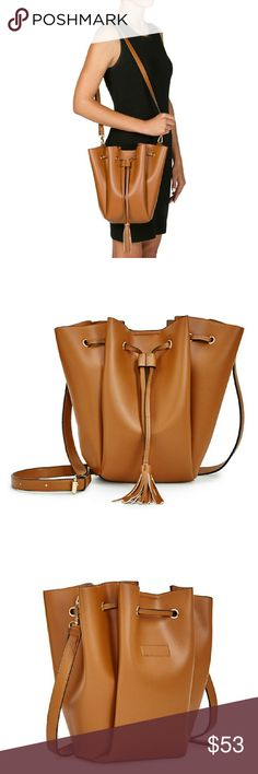 """Ewan Tassle Bag Ewan is your perfect on the go bag. This drawstring handel, with tassel, adds perfect style. Hardware is gold, and made of faux leather.  11"""" length, 12"""" high and 3"""" deep. Drop 24"""" The color is called Cognac Its new with tags. JUSTFAB Bags Hobos"""
