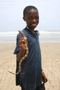 Ghana - Boy holding a sea snake / Labadi Beach