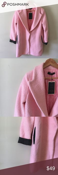 PRICE DROP! NWT Pandora Pink Coat NWT! Beautiful pink wool-type coat with darling charcoal gray cuffs and matching pockets (real, not faux!). It's a cotton candy pink for that perfect pop of color in that super on-trend slouchy fit. Single snap button front with a little bit of discoloration from the metal (almost invisible and not at all visible when buttoned). Materials not listed on tag. Feels like wool exterior with polyester quilted lining but that is just my impression! Size: L but…