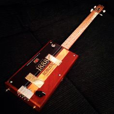 Dual pickup CBG. Get yours at http://www.jagshouse.com/cigarboxguitars.html