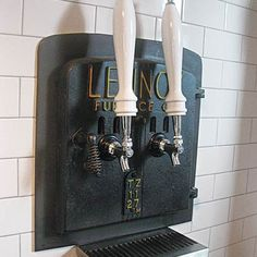 Kegerator/home bar idea: custom tower with hidden refrigerator.