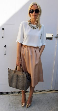 What the stylists are wearing in London: the chic Martha Ward wears a pretty palette of neutral tones of Stella & Dot necklace, Gerard Darel top, Wilfred NYC skirt, Tods bag, Michael Kors shoes and Armani sunglasses at London Fashion Week.   Photograph by Jane de Teliga