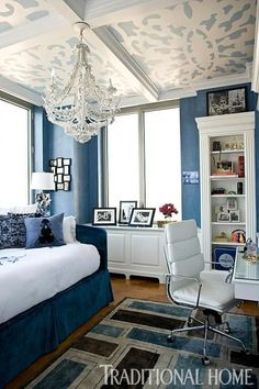 Varying shades of blue are enhanced by white and grounded with brown. - Traditional Home ®/ Photo: John Bessler / Design: Brad Boles