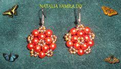 Aros pendientes estrella ARTESANALES con perlas anaranjadas y mostacillas . Orange Handmade star beaded earrings