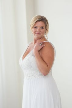 Justin Alexander Bridal - Plus Size Wedding Gown. Beaded top with a flowy a- 65375d8340a9