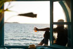 Le Caprice, Mykonos, glass doors, ocean, sunset, wine / Garance Doré