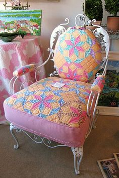 Wrought iron chair and reused quilt.