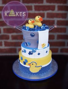 Rubber Ducky baby shower cake! Bottom two tiers are iced in buttercream. Bucket on top is covered in marshmallow fondant (MMF). MMF ducks, towel, bubbles and decorations.