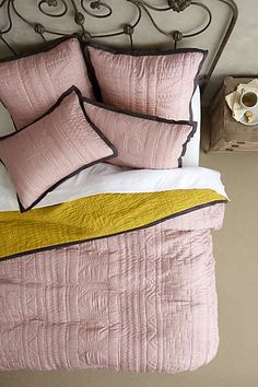 Lilac and chartreuse quilted bedding from Anthropologie.