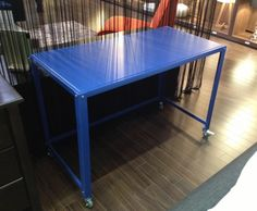 New EQ3 Frame desk in blue!!! This is an awesome piece to add a pop of colour to your space! There is also a plasma unit, coffee and end table, 3-tier and 5-tier shelf. Also available in black.