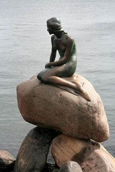 The famous Little Mermaid that watches over the Harbor in Copenhagen, Denmark.