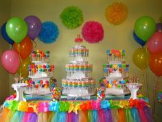 Rainbow themed party  Love the table tulle by janell