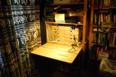 Hidden Workbench in a Bookshelf - IKEA Hackers Materials: Ivar – shelf, Nobro-folding table Description: Since space is very rare in my flat I m Small Workbench, Tool Workbench, Electronic Workbench, Workbench Ideas, Fold Away Table, Drop Down Table, Built In Bookcase, Bookshelves, Small Cabinet With Drawers