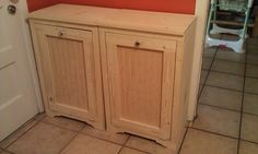Wood Tilt-Out Trash Bins   Do It Yourself Home Projects from Ana White  This would be good to hide my trash and recycling in the kitchen