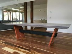 Polished concrete table top with a timber and steel base by Mitchell Bink Concrete Design. www.mbconcretedesign.com.au