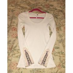 Free People oat meadow fiesta cuff thermal  GUC. Never worn by me. Trade offers welcome.  See all pics for condition: 1.) No armpit stains  2.) One small grey-ish dot on back of sleeve & on neckline 3.) One small pull on back left sleeve (right pic) & on the front near the bottom (left pic). *Please note*  Previous buyer returned bc the grey dot/mark is apparently mildew, & is a bother if severely allergic. I was unaware of what it was until that happened. It is unnoticeable if you don't…