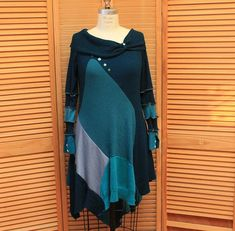 Boho sweater tunic wearable art top Up-cycled clothing Hippie urban wear Womens tunic dress Eco fashion teal green Med-Large This one of a kind tunic dress is made from recycled sweaters and fit sizes 8-10- 12, long striped sleeves with buttons, uneven hem,cowl neck collar, acrylic wool