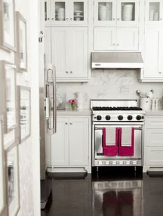 I actually pinned this for the hot pink hand towels. Love it in this white kitchen.