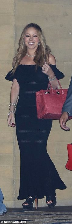 All eyes on her:Clad in a skintight maxi dress, the 46-year-old singer highlighted her hourglass curves as she sashayed into the celebrity hotspot flanked by her security detail