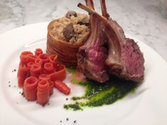 Rack of lamb with mushroom risotto in a potato basket with pickled carrots