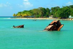 The tops of wreckage emerge from the turquoise water at Nicaragua's Corn Islands.