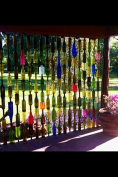 Sun catcher wall of wine bottles, awesome!