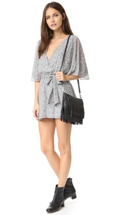 Metallic threads lend low-key sparkle to this floral-printed Rebecca Minkoff romper. Deep V neckline and self-tie sash at the elastic waistband. Back slit. Lined.